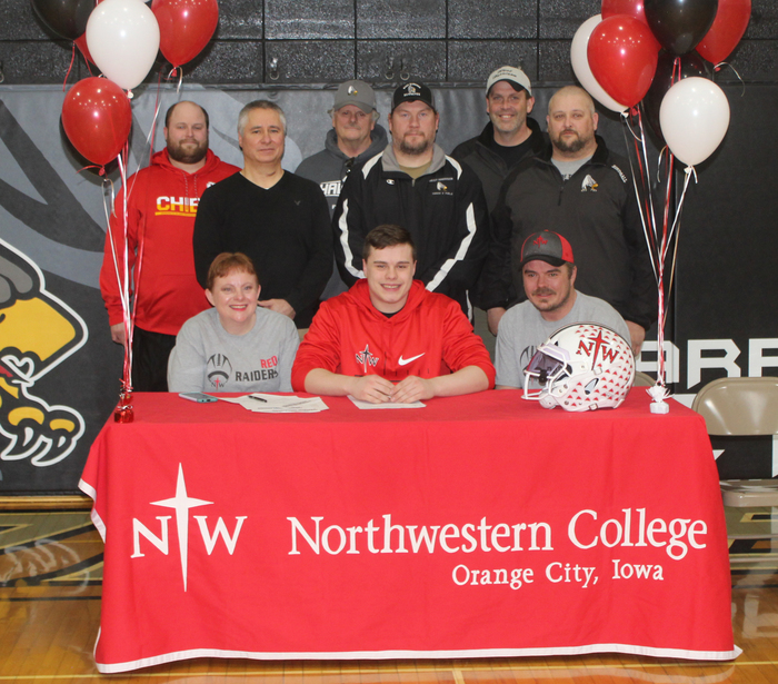 Congratulations to Corbin Pavlik's signing with Northwestern College of Orange City, Iowa to play football and to wrestle. Pictured: At table: Mom- Becky Pavlik, Corbin Pavlik, Dad- Jason Pavlik 1st Row Standing- AD Tony Nunez, Wrestling Coach Steve Forbes, Football Coach Craig Birdsall Back Row- Football Coach Andrew Stevenson, Track Coach Gregg Beam, Football Coach Rowdy Evans